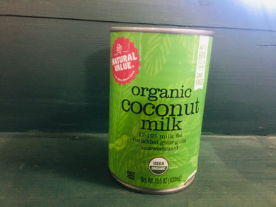 Can of coconut milk on shelf