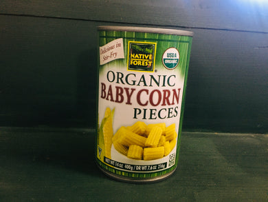 Can of corn on shelf