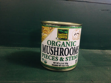 Short can of mushrooms on shelf