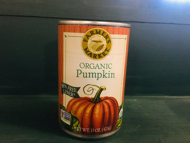 Closeup of can of pumpkin on wooden shelf