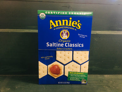 Closeup of box of saltines on wooden shelf