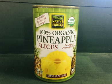 Can of pineapple slices on wooden shelf