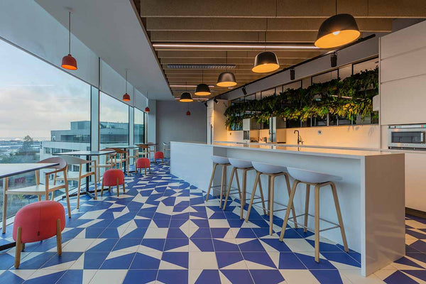 Counter with stools and blue tiles on floor