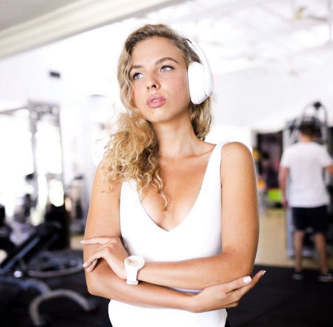 Girl in the gym with Rival Headphones
