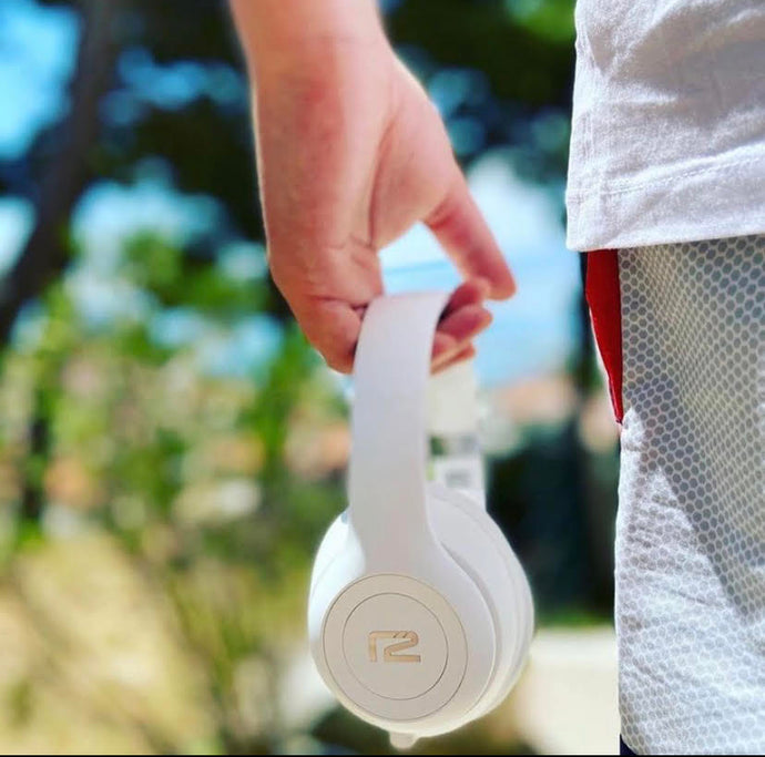 Person holding Rival Headphones White