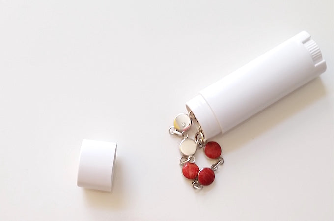 store jewelry in old lip balm tubes