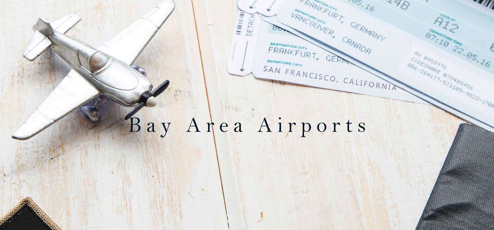 Toy airplane and plane tickets departing SFO