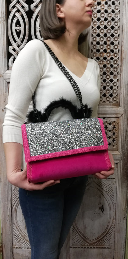 Luxury fuschia textile glitter bag with velvet details