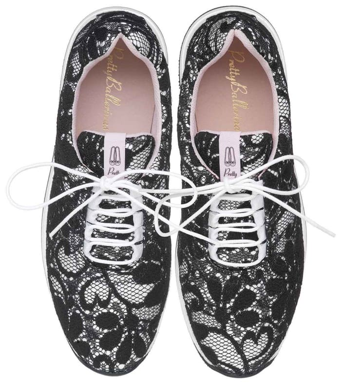 Worn by Olivia Palermo.Black sneakers with lace