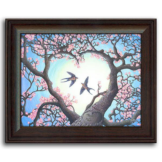 Nature wall decor of two branches that create a heart with two birds flying in the middle - Personal-Prints