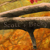 personalization detail of birds of a feather names carved into tree branch