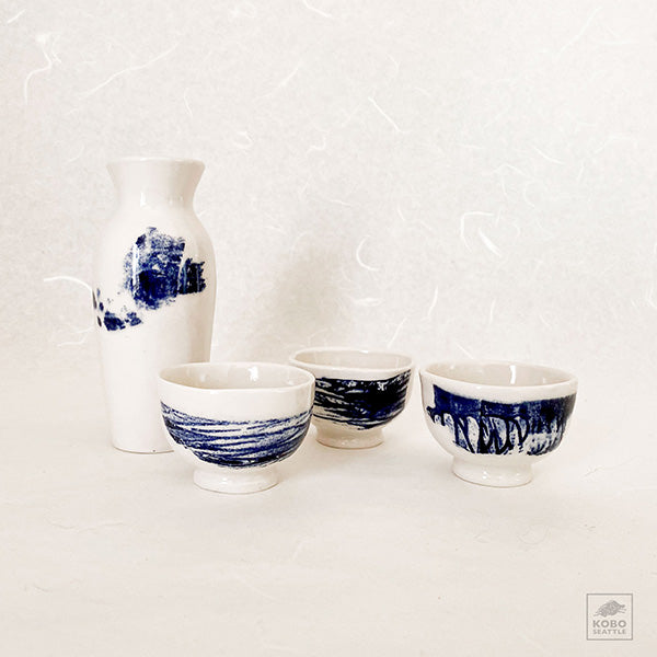 Sake Bottle and three cups