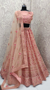 Surpassing Peach Colored Bridal Designer Heavy Work Coding And Resham Embroidered Work Lehenga Choli