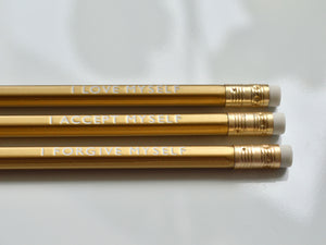 Gold foiled affirmation pencils reading: I love myself, I accept myself, I forgive myself