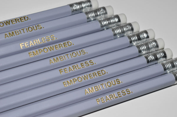 Gold Foiled empowered pencils reading: Empowered, Fearless, Ambitious