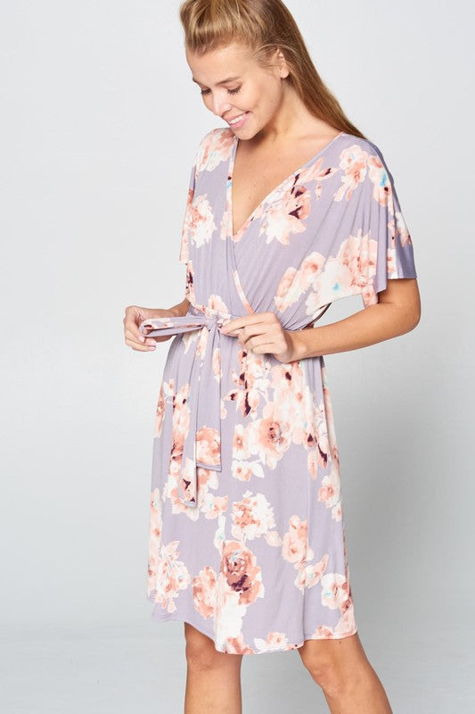 A mini-length dress featuring V-neck shaped neckline