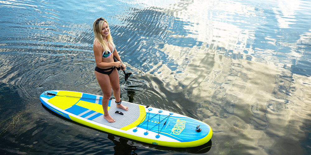 Girl paddling on a TRAVLR SUP, front side view