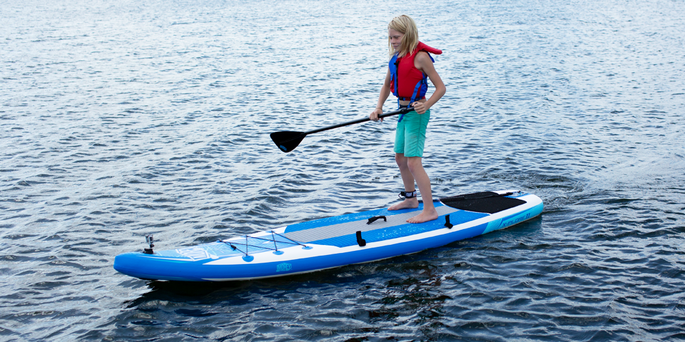 Boy paddling on a X-PLORE SUP, front side view