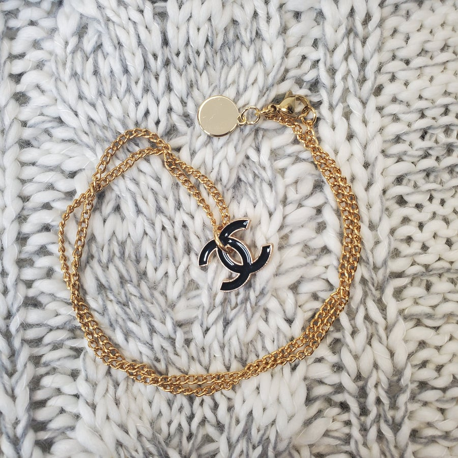 Gold Necklace With Small Vintage Black Chanel Charm