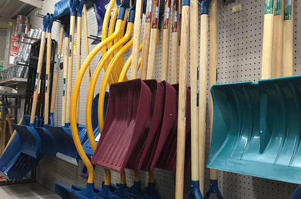 shovels hanging on wall