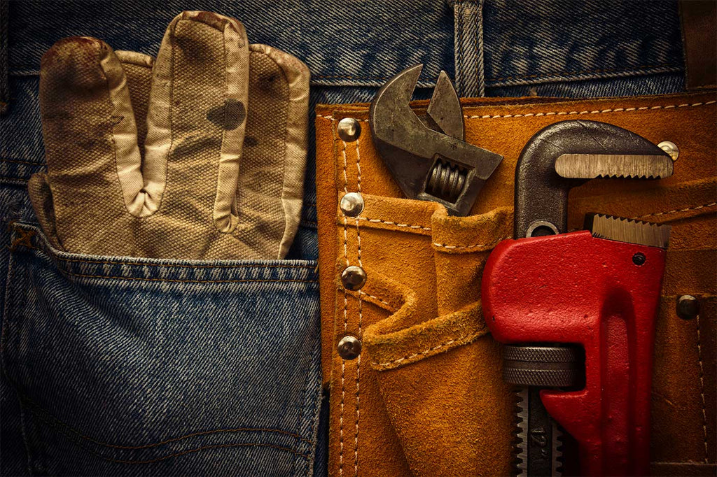 jeans with gloves and two wrenches in pockets