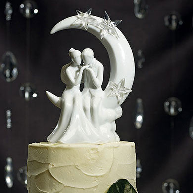 Man Kissing Woman's Hand on Moon Cake Topper Close Up