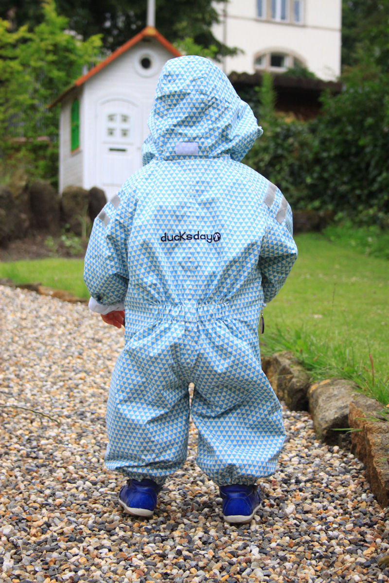 Toddler walking  in Ace Light Blue Rain suit