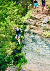 Jason jumping off a cliff into Lake Norris in East Tennessee