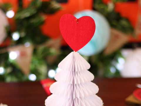 Red heart christmas decoration on honeycomb tree