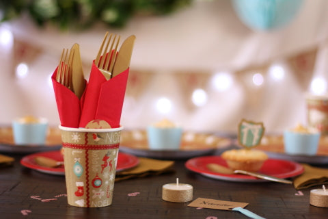 Paper Christmas cups and matching gold cutlery