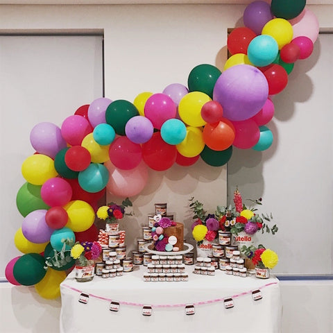Nutella party dessert table with balloon arch