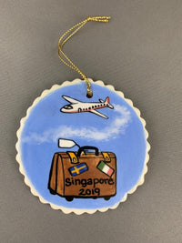 Airplane and suitcase ornament