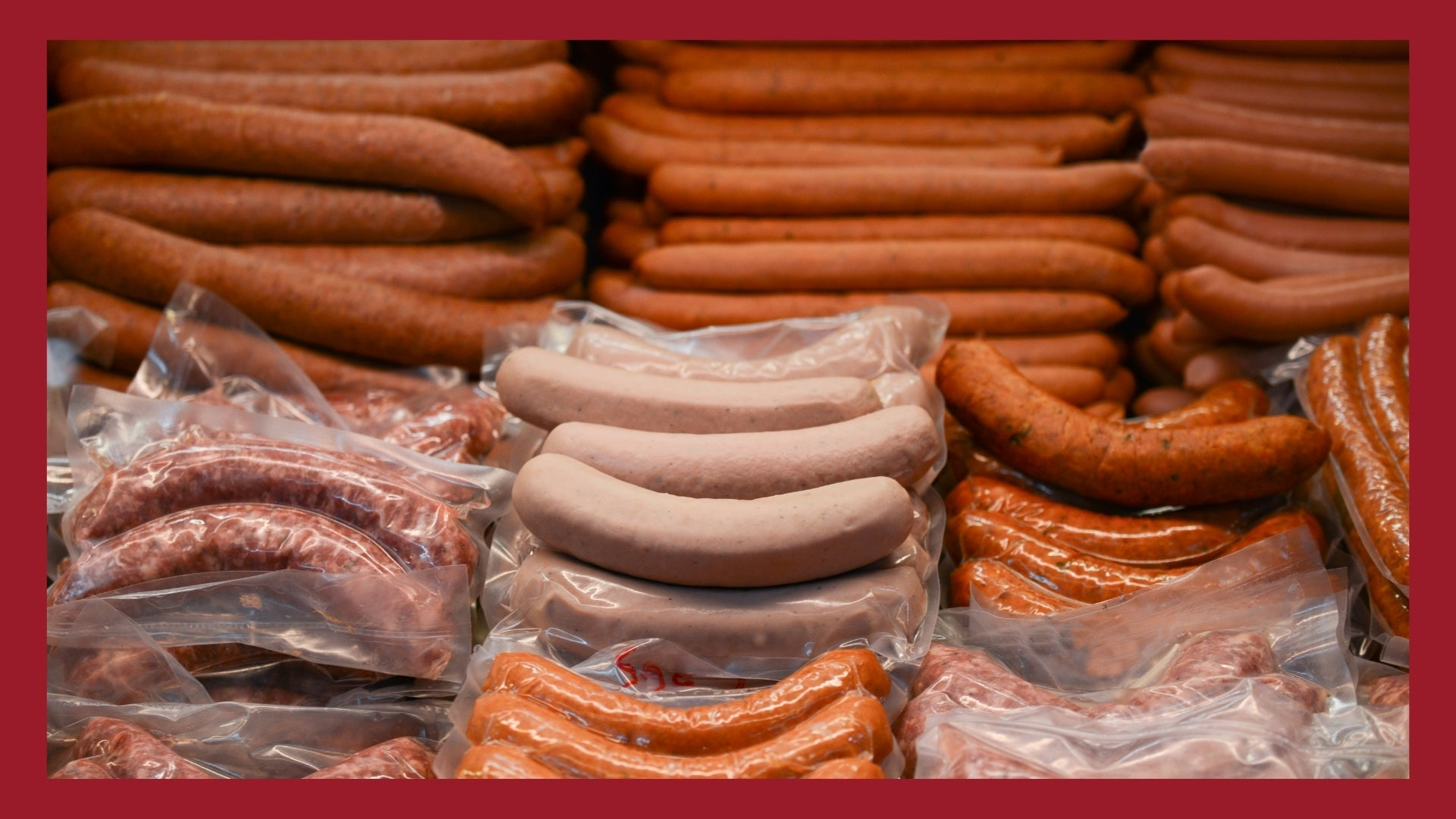 A bunch of different types of sausages in a big pile.