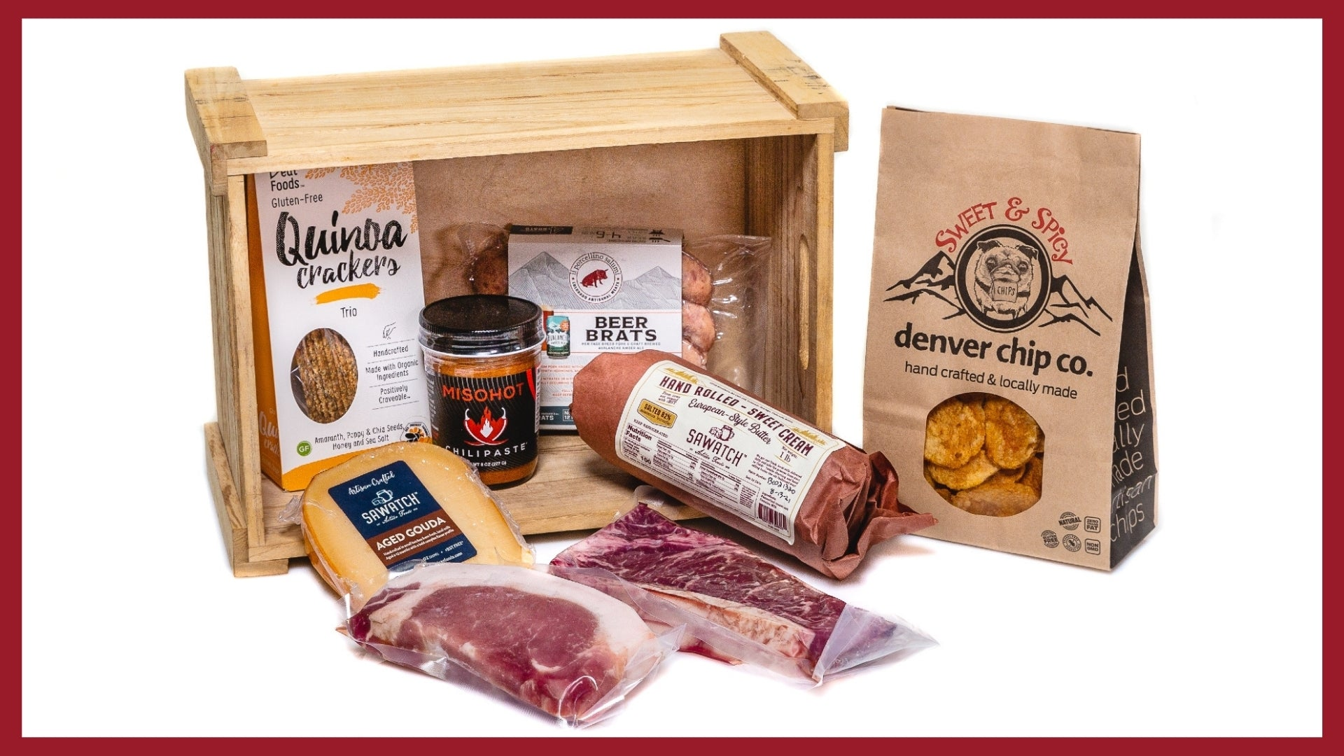 A picture of products in a CSA box from il porcellino salumi which includes whole muscle meat, crackers, salami and more.