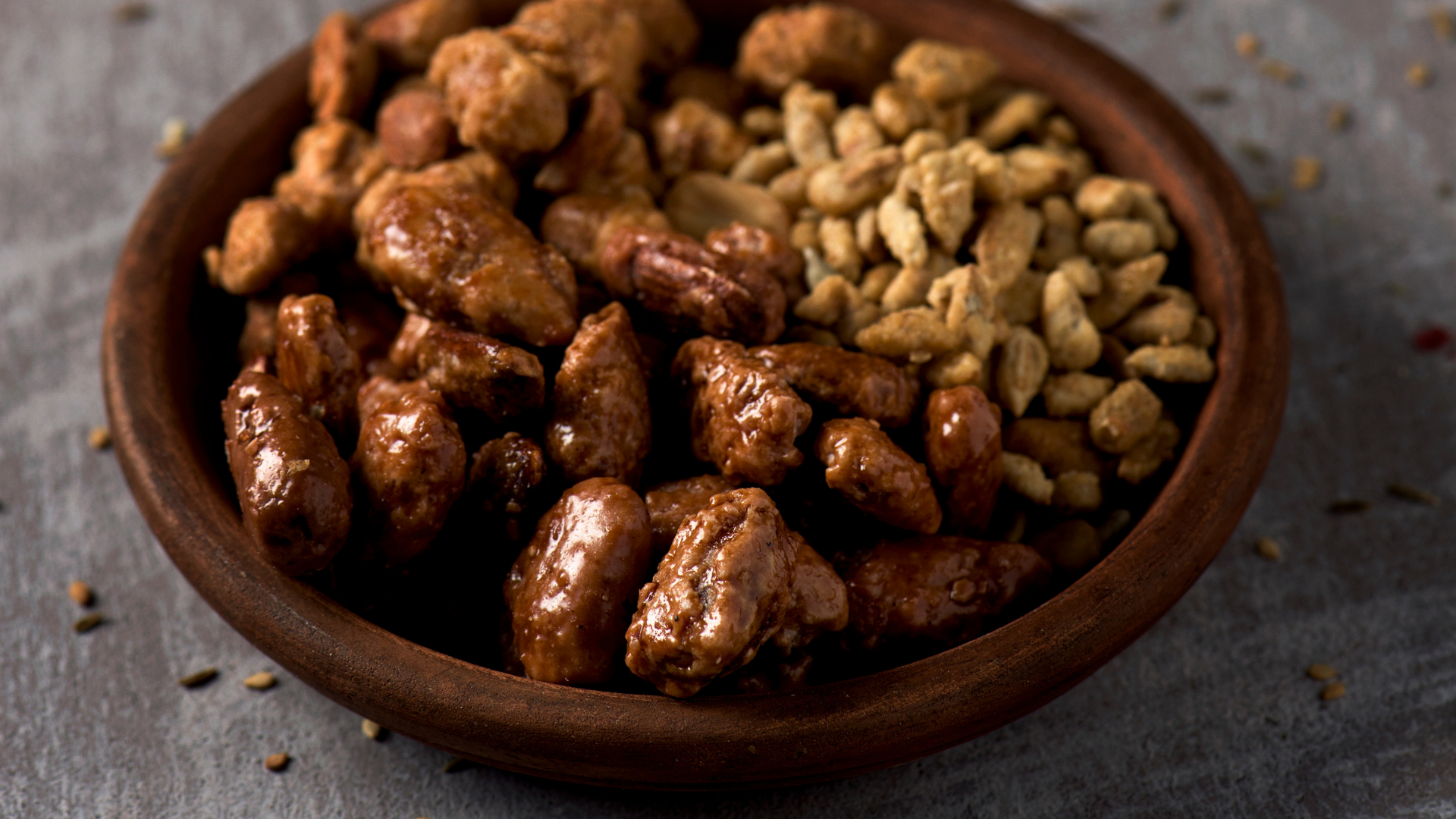 A bowl holding candied nuts.