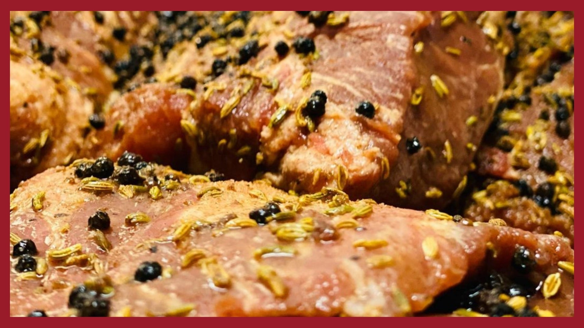 A close up picture of coppa meat curing in a blend of herbs and spices.