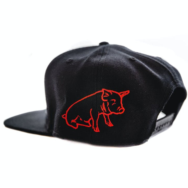 A black baseball hat angled to show the back left and snap adjustment. il porcellino salumi's logo is outlined on the back left of the hat.