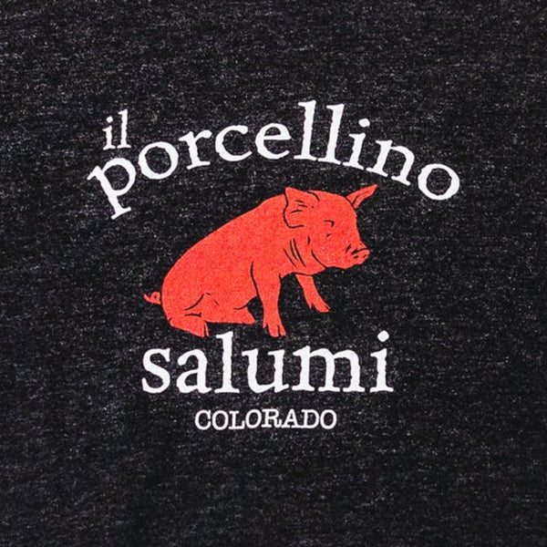 A close up of il porcellino salumi's logo screen printed on a black shirt.