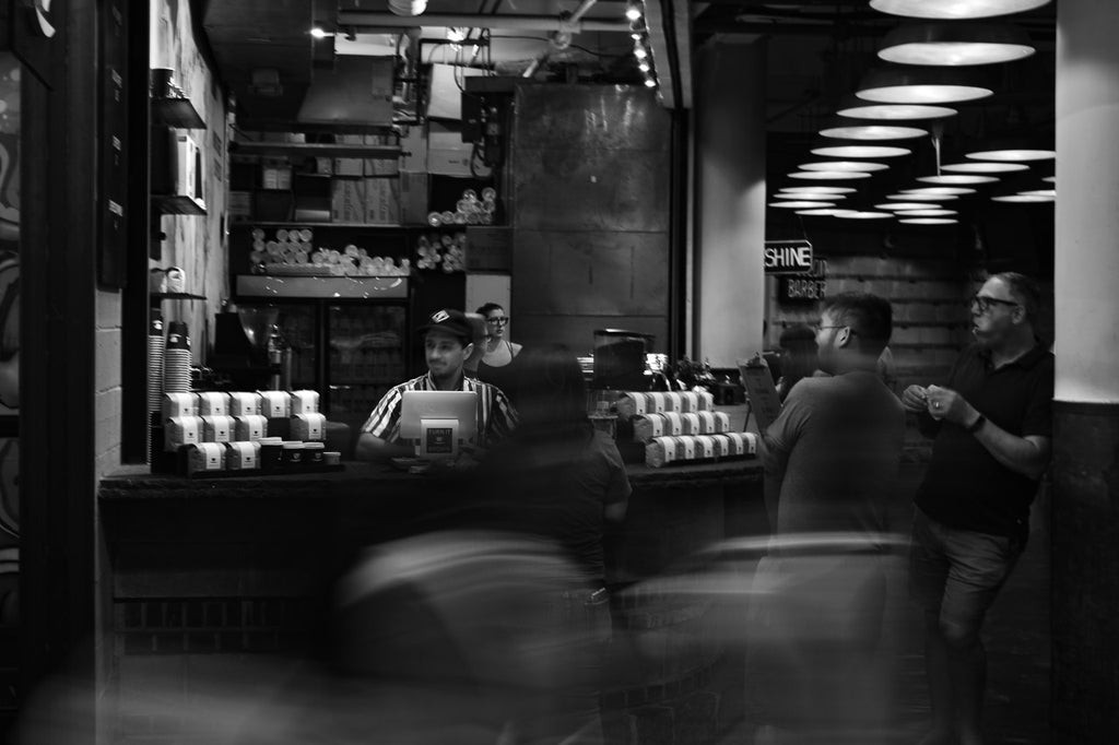 Ninth Street Espresso kiosk at the Chelsea Market, black and white.