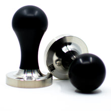 Load image into Gallery viewer, Two EC1 Tampers with black handles and stainless steel pistons; one upright and one on it's side.