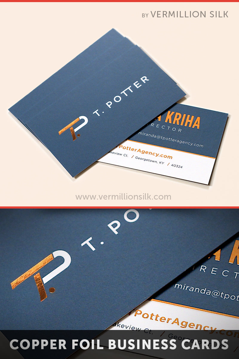 Copper foil stamped silk business cards with blue ink