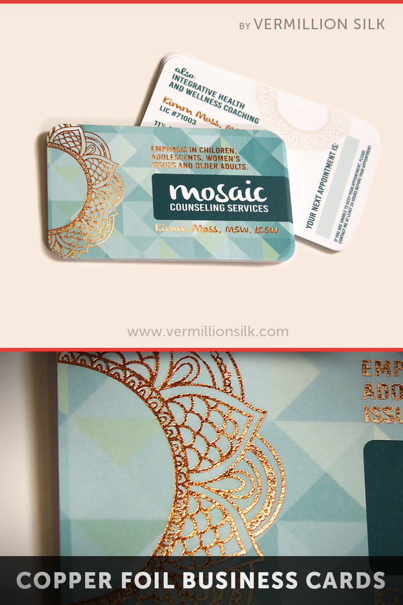 Teal rounded business cards with intricate copper foil stamp pattern