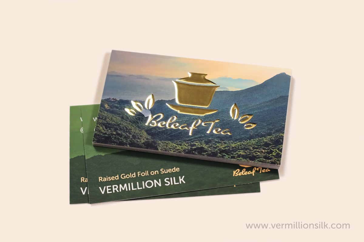 raised gold foil business cards with suede lamination