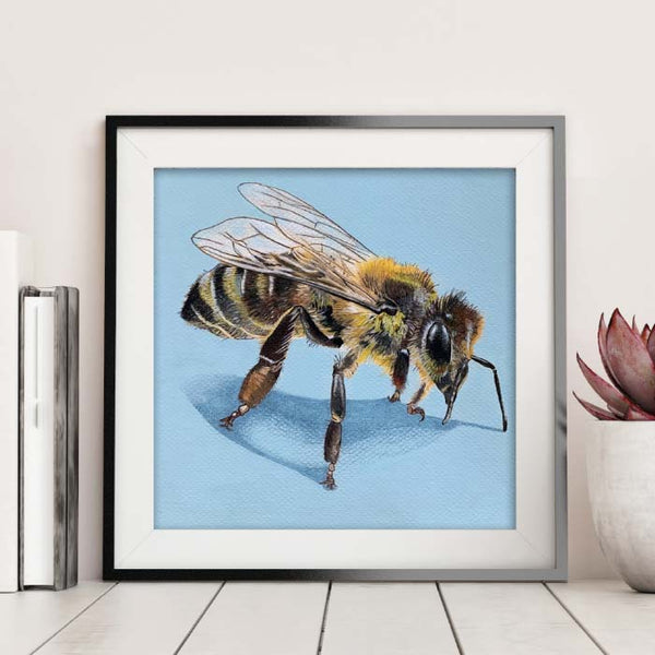 honey bee pencil drawing on blue paper