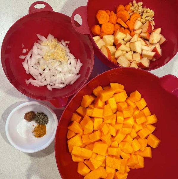 chopped squash, carrots, onion, garlic, apples, ginger and spices.
