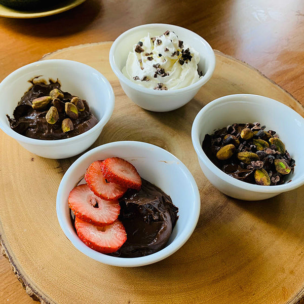 chocolate avocado pudding with fruit and nuts