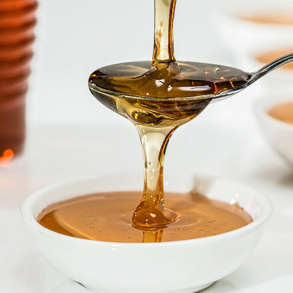 honey drizzled over a spoon
