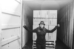 Deborah Semer in the warehouse with the first container ship of Joyboxx