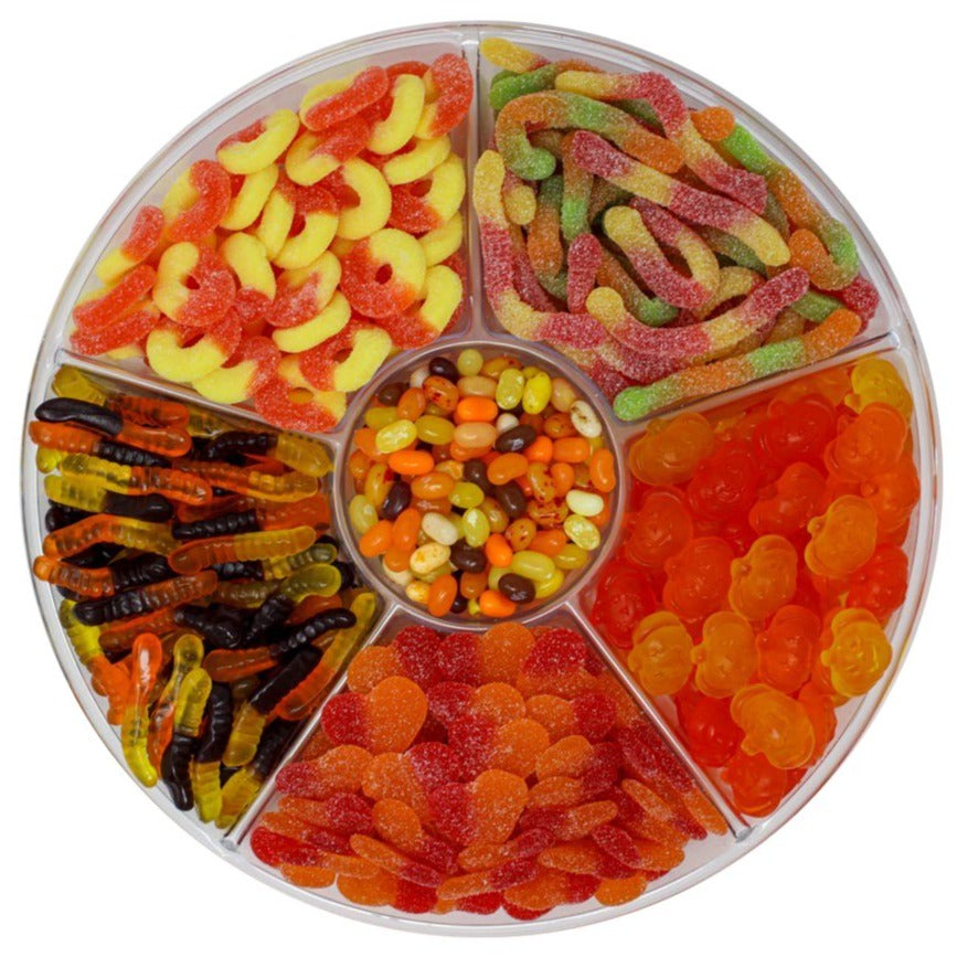 candy platter with Gummy Pumpkins, Sour Peach Rings, Sour Peach Hearts, Flavorful Jelly Bellies, Gummy Worms & Sour Worms.