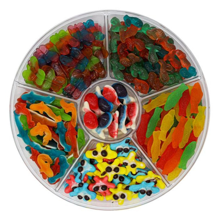 candy platter with Swedish Fish, Sand Sharks, Colorful Butterflies, Gummy Mermaid Tails, Gummy Whales and Gummy Blobs and more